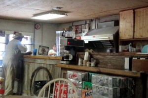 "Here's a shot of the counter and gigantic grill behind it.  Can you say, ""Hole in the Wall""?"